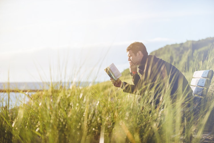 Speed reading - a man on a bench